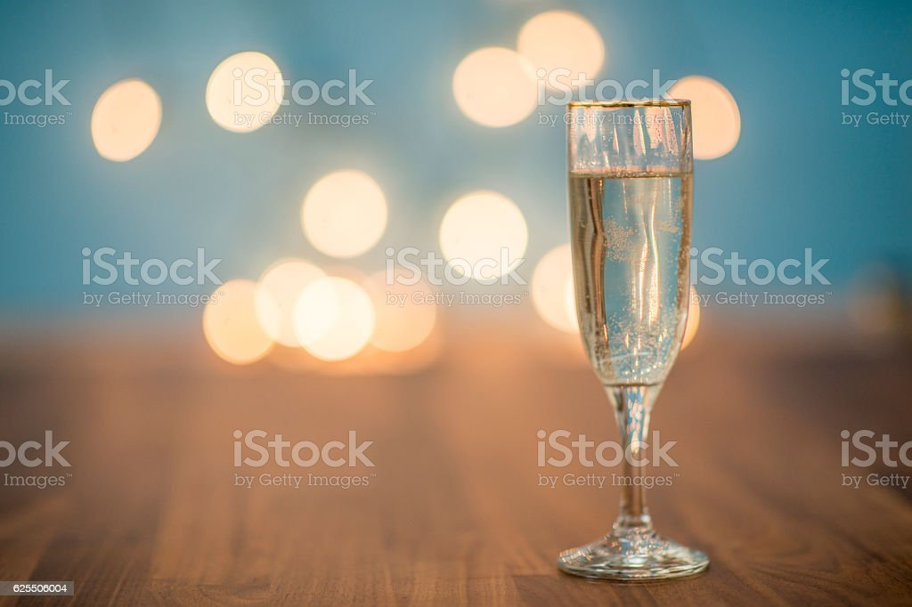 Lonely Champagne Glass on New Year's Eve stock photo
