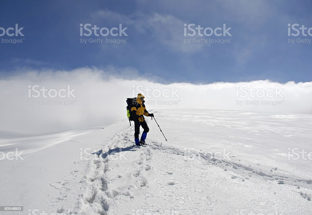 Lonely climber on  top of mountain royalty-free stock photo