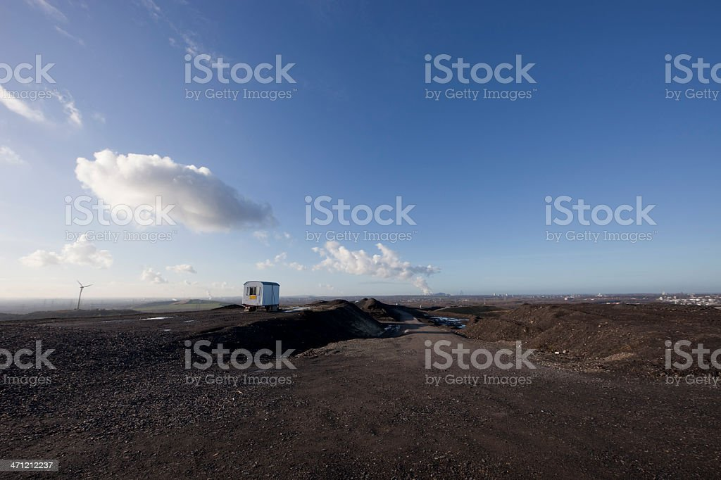 Lonely Construction Trailer on large Heap royalty-free stock photo