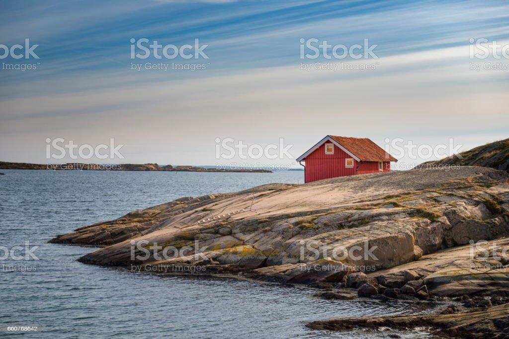 Lonely cottage at Swedish west coast stock photo