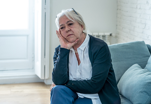 874789168 istock photo Lonely depressed senior old widow woman crying on couch in isolation at home, feeling sad and worried missing husband and family in COVID-19 Outbreak, lockdown, social distancing and Mental health. 1251790420