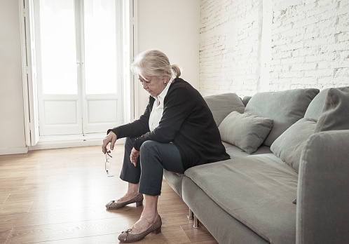 874789168 istock photo Lonely depressed senior old widow woman crying on couch in isolation at home, feeling sad and worried missing husband and family in COVID-19 Outbreak, lockdown, social distancing and Mental health. 1251790421