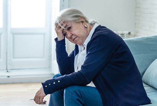 874789168 istock photo Lonely depressed senior old widow woman crying on couch in isolation at home, feeling sad and worried missing husband and family in COVID-19 Outbreak, lockdown, social distancing and Mental health. 1251790498