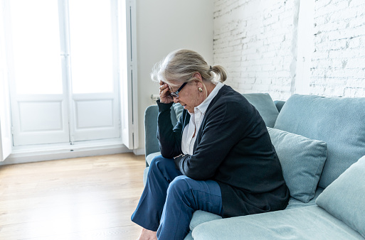 874789168 istock photo Lonely depressed senior old widow woman crying on couch in isolation at home, feeling sad and worried missing husband and family in COVID-19 Outbreak, lockdown, social distancing and Mental health. 1251790500