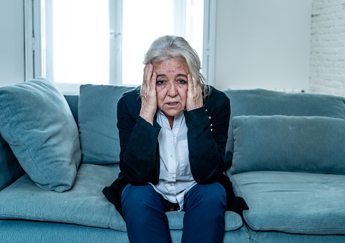 874789168 istock photo Lonely depressed senior old widow woman crying on couch in isolation at home, feeling sad and worried missing husband and family in COVID-19 Outbreak, lockdown, social distancing and Mental health. 1251790501