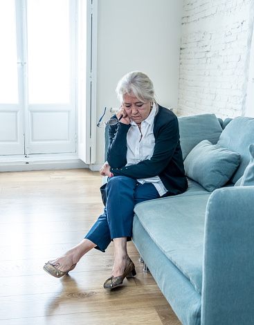 874789168 istock photo Lonely depressed senior old widow woman crying on couch in isolation at home, feeling sad and worried missing husband and family in COVID-19 Outbreak, lockdown, social distancing and Mental health. 1251791649