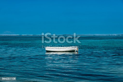 lonely fishing boat resting in the indian ocean on mauritius island in africa.