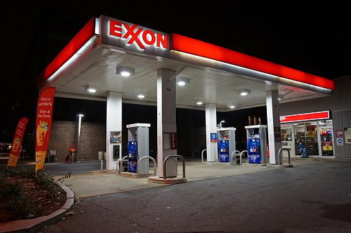 Washington DC, USA-November 29, 2014:  This Exxon gas station was spotted at night in Northwest Cleveland Park in Washington DC.  It is empty at this hour though gas prices have fallen making travel more affordable.