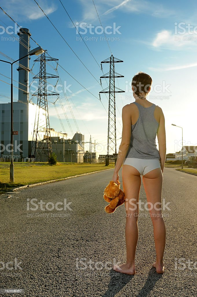 Lonely girl at the plant royalty-free stock photo