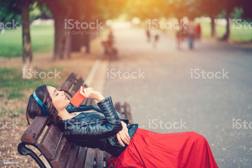 Lonely girl in the park stock photo