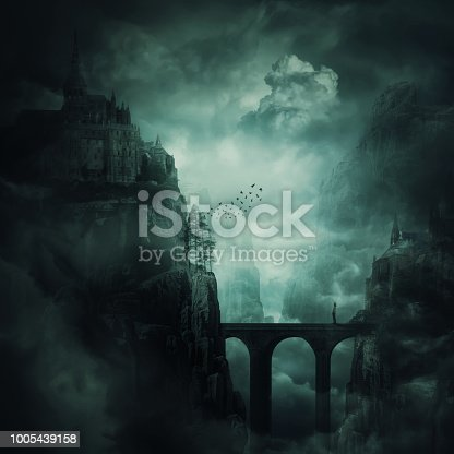 Surreal view as a lonely girl stand on a stone bridge surrounded by dark mountain cliff with castle and old buildings on the top. The forgotten kingdom, creepy background.