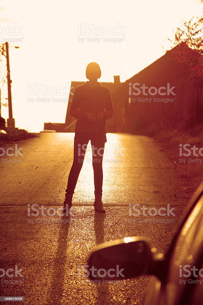 lonely girl walking stock photo