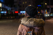 istock Lonely girl walking through night city street 635941772