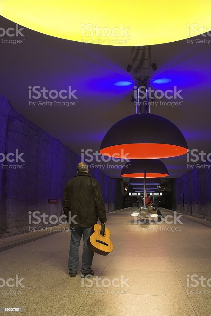Lonely guitarist at the subway station royalty-free stock photo