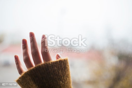 Lonely hand on the window