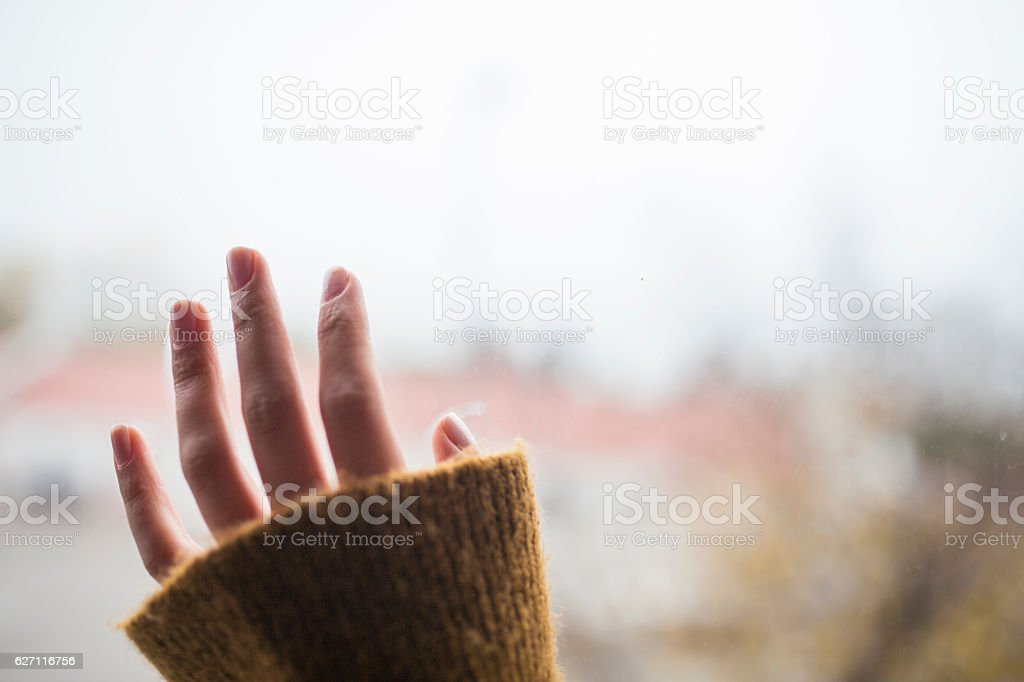 Lonely hand on the window stock photo