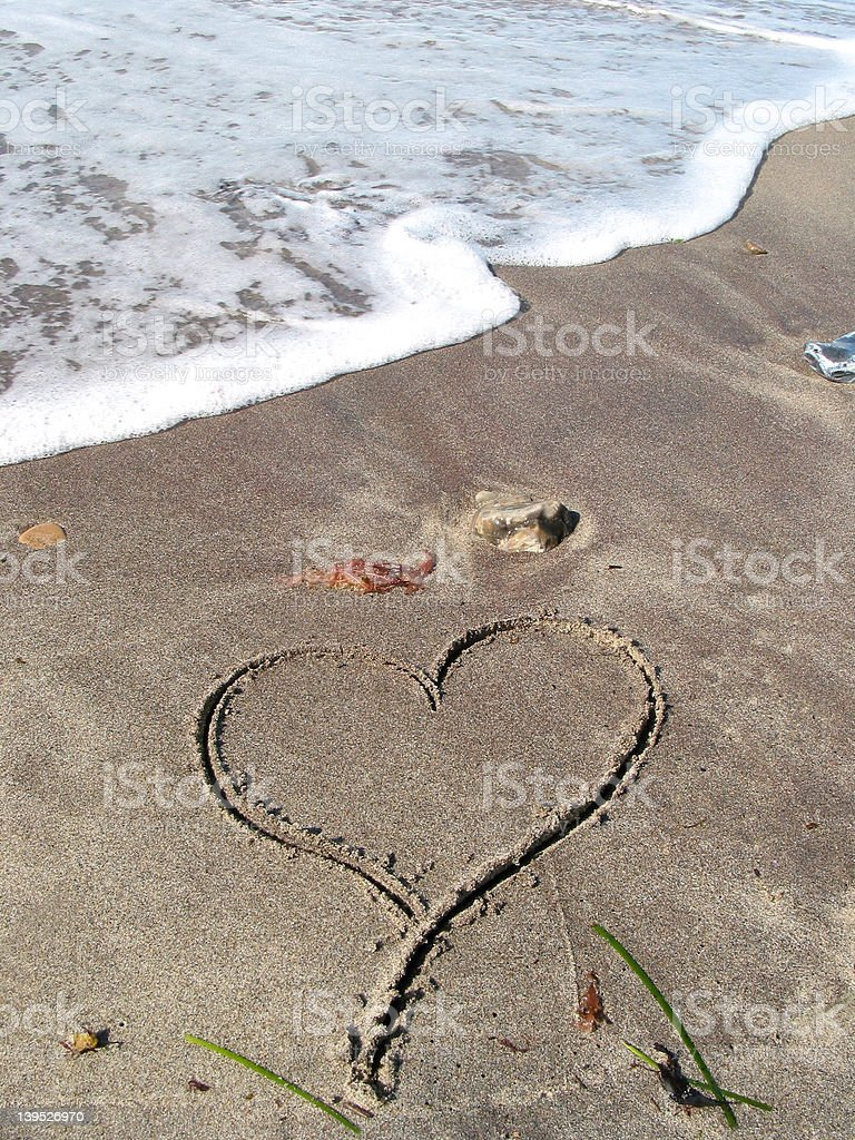 Lonely heart on the beach royalty-free stock photo