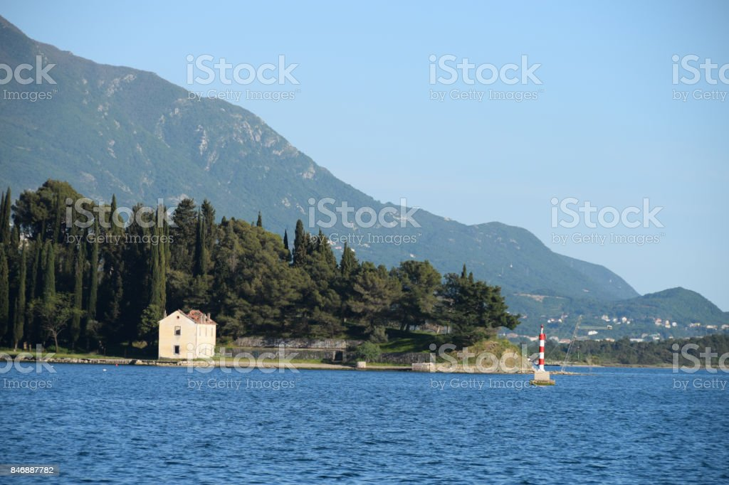 Lonely house on the beach, with the forest in the background stock photo