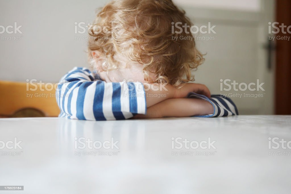 Lonely little boy being sulky stock photo