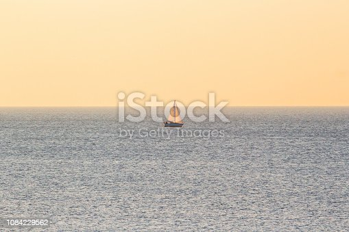 lonely little sailboat in the middle of the ocean
