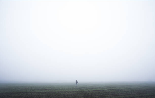 lonely man in a fog - lost stock photos and pictures