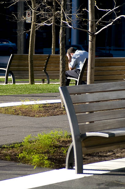 Lonely man in a public park stock photo