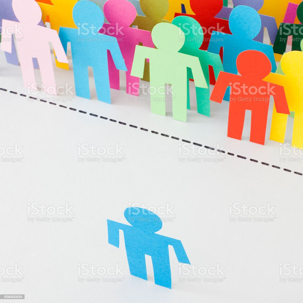 Paper stick figure of men standing in front of lots of other men...