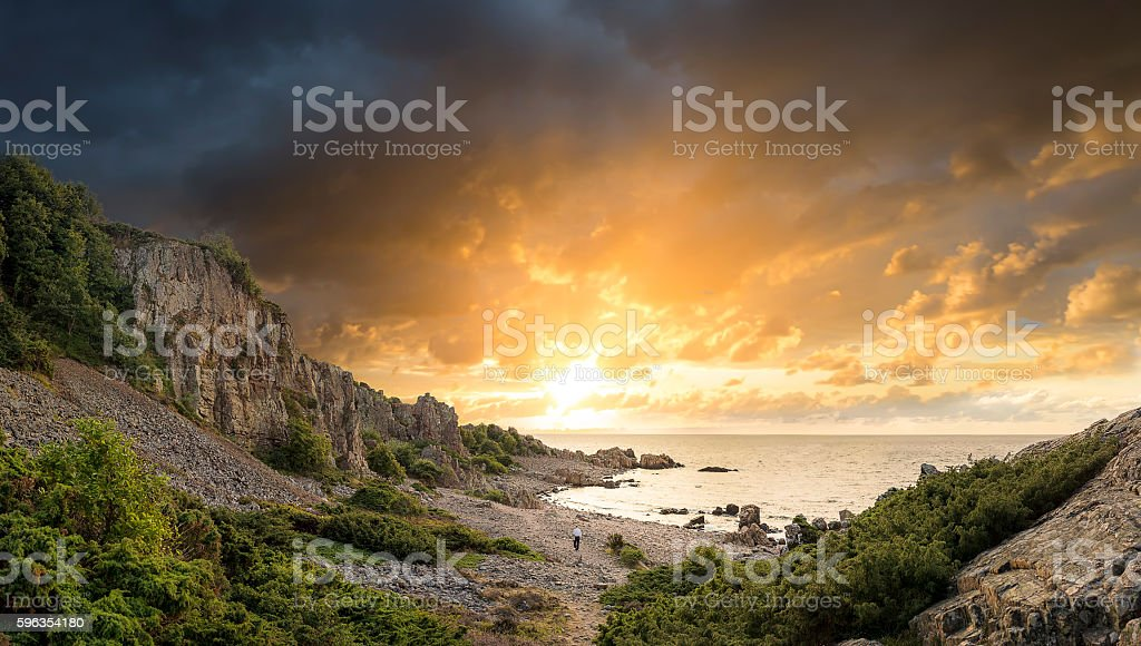 Lonely man in sunset stock photo