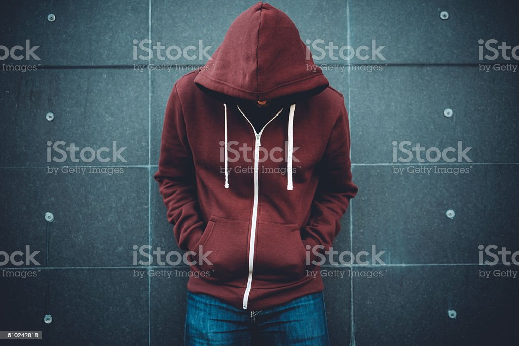 Lonely Man Leaning against an urban wall stock photo