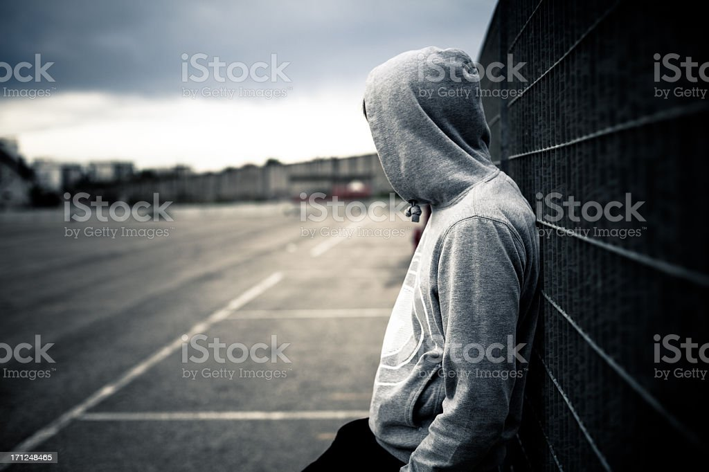 Lonely Man Leaning on a Fence stock photo