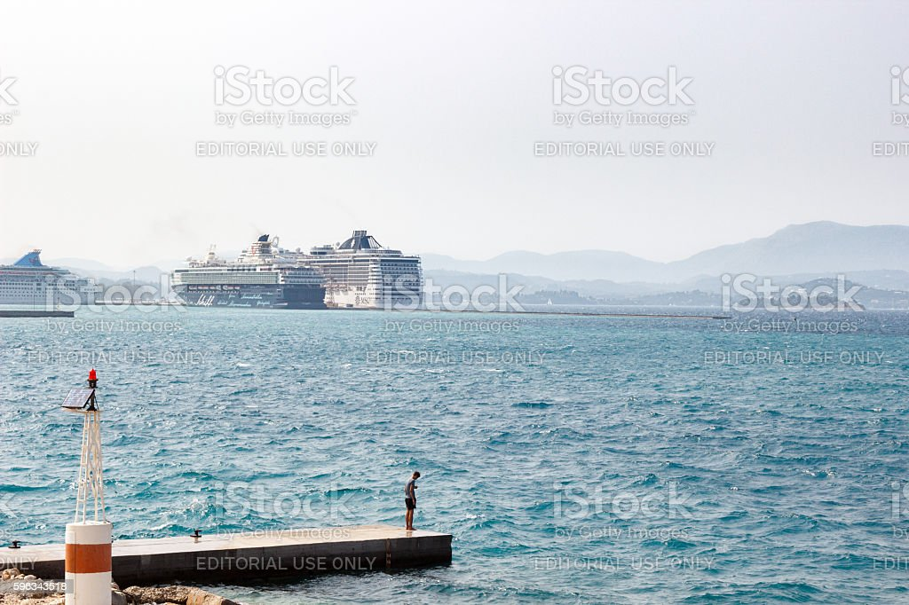 Lonely man looking down at the wavy sea. royalty-free stock photo