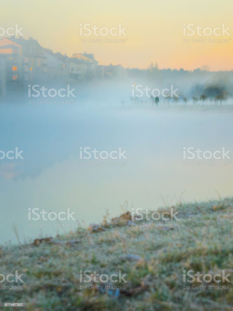 Lonely man walking on a foggy park stock photo
