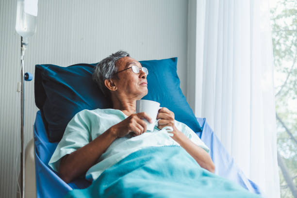 lonely old asian patient on patient bed in hospital - cancer patient stock pictures, royalty-free photos & images