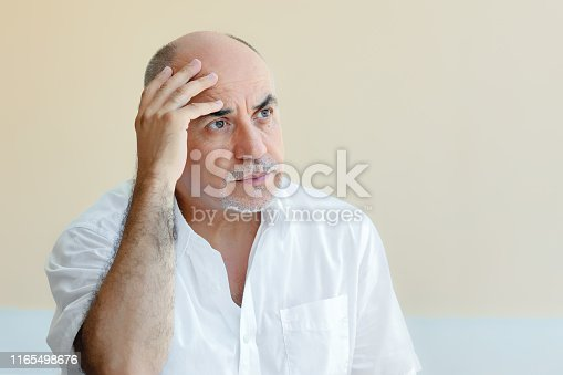 istock lonely old man waiting with sadness 1165498676
