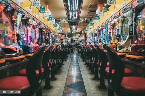 istock Lonely Pachinko Gambler Osaka Japan 1073731280