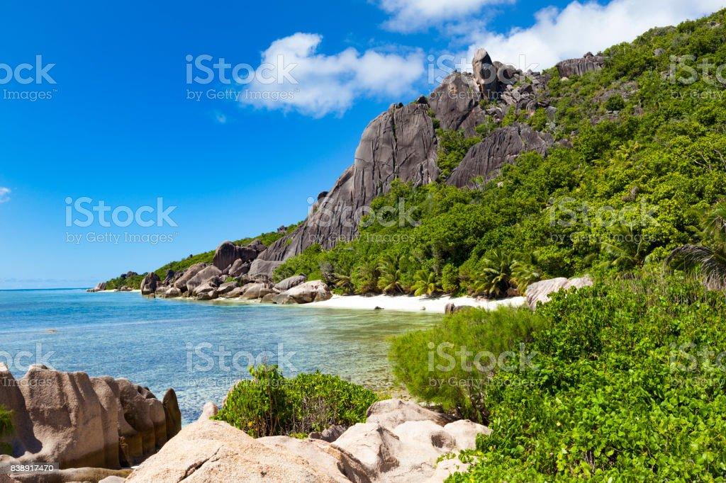 lonely paradise beach, la digue island, seychelles stock photo