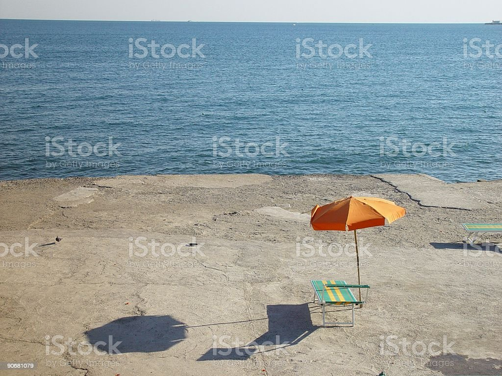 Lonely Parasol and Chair Close To The Sea royalty-free stock photo