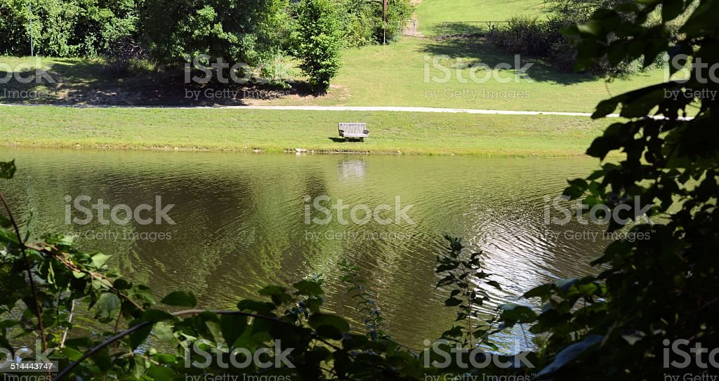 Lonely Park Bench at the Lake stock photo