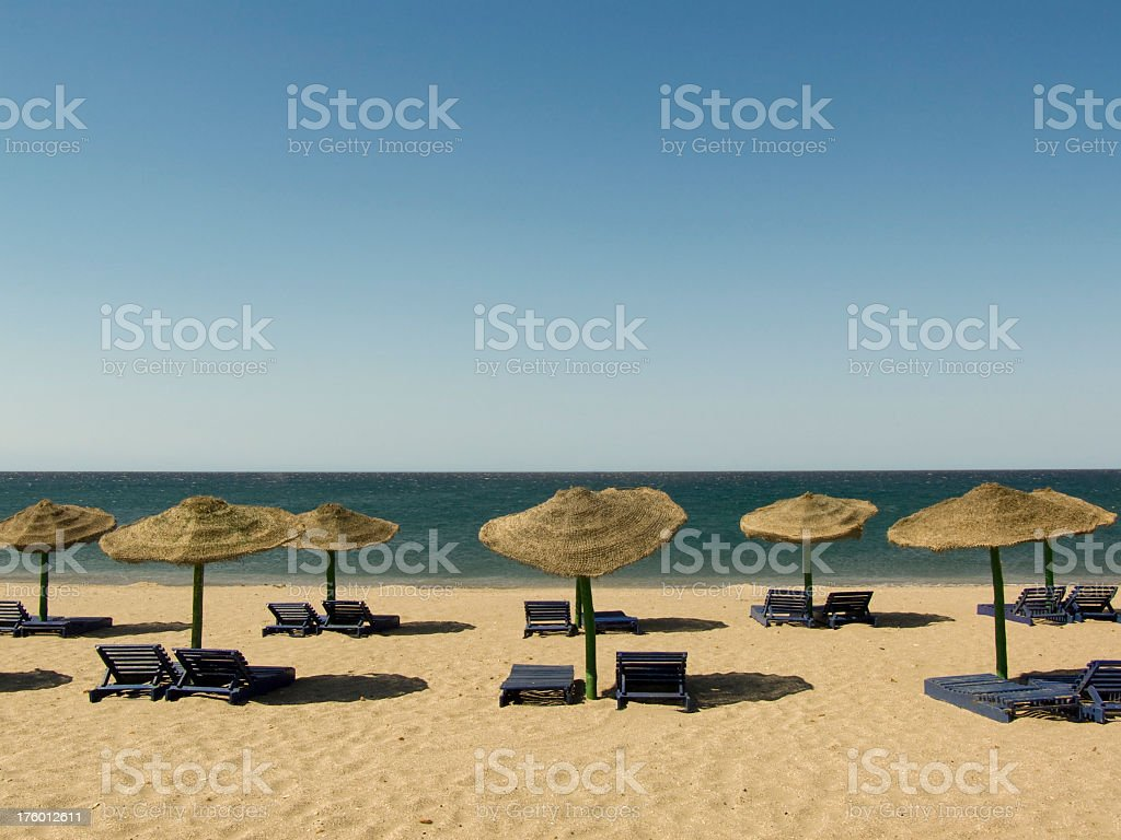 Lonely peaceful beach with lots of sits stock photo