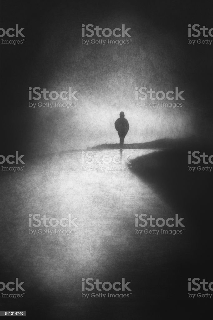 lonely person walking with grungy textures stock photo