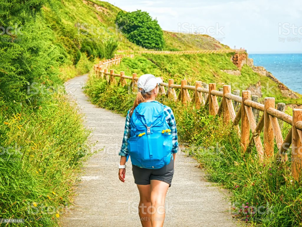 Lonely Pilgrim with backpack walking the Camino de Santiago in Spain, Way of St James stock photo