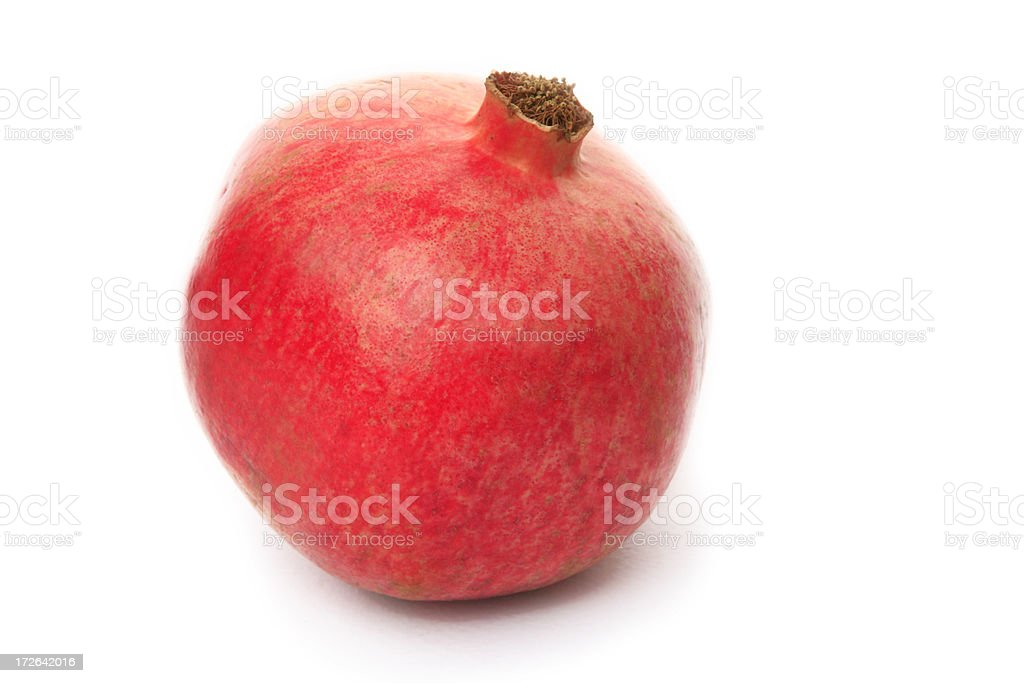 lonely pomagranate on white stock photo
