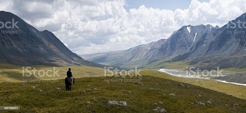 Lonely Rider at Altay Mountains stock photo