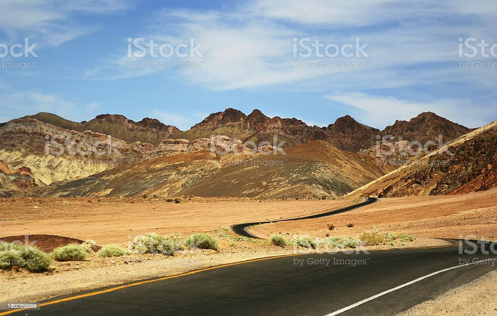 Lonely Road Through Mountains royalty-free stock photo
