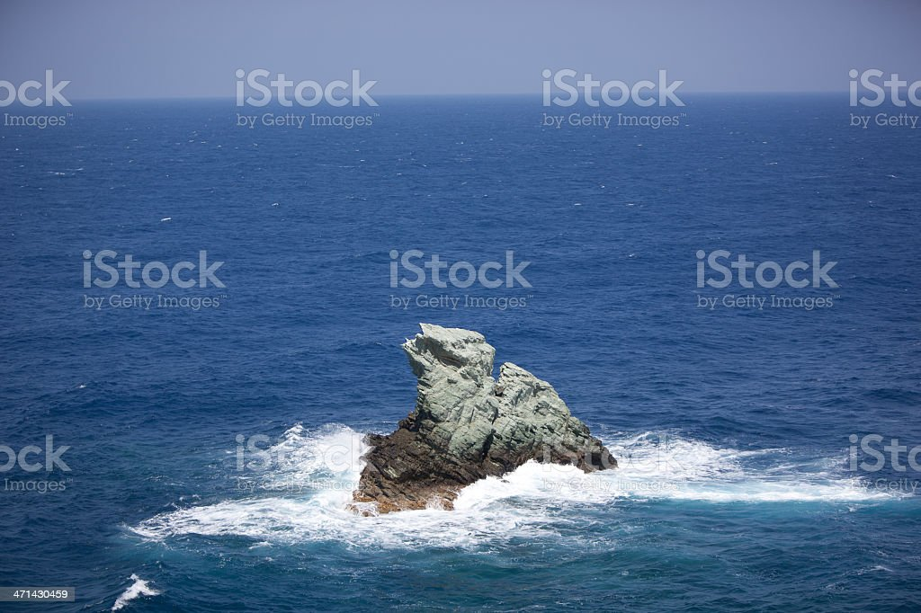 Lonely rock at the sea stock photo