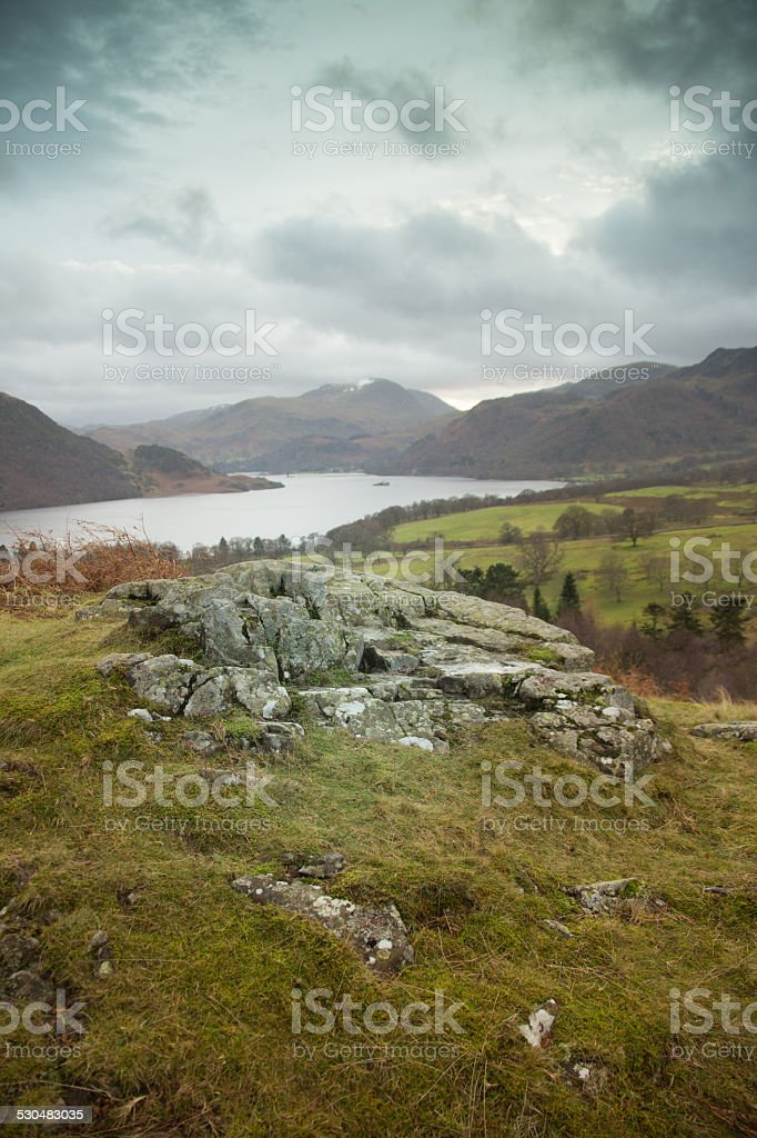 Lonely Rock Looking At A Lake stock photo