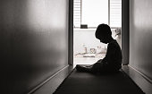 istock Lonely sad boy at home 1277213578
