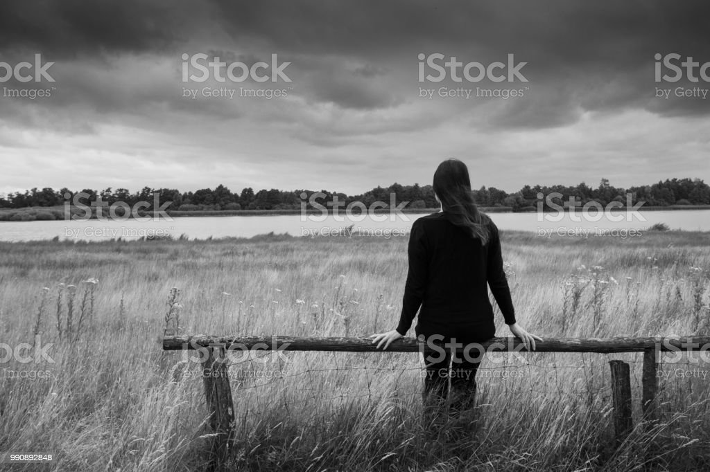 Lonely And Depressed >> Lonely Sad Depressed Female Is Sitting Alone On A Wooden Beam Or