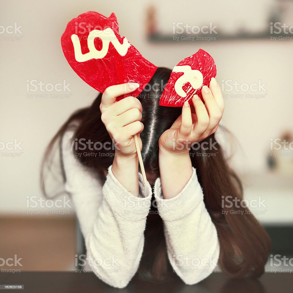 Lonely sad girl with broken heart stock photo