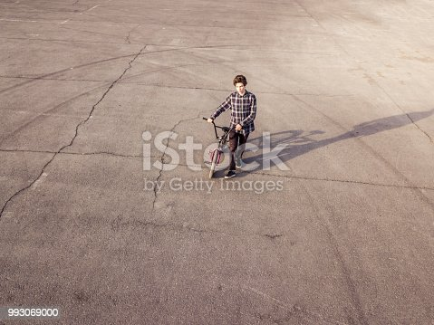 lonely sad man walking with bicycle on asphalt isolated